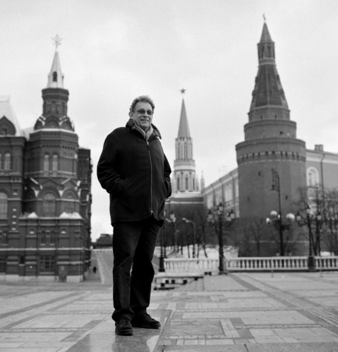 Pollack standing at entrance of Red Square with Kremlin in background, Moscow, Russia