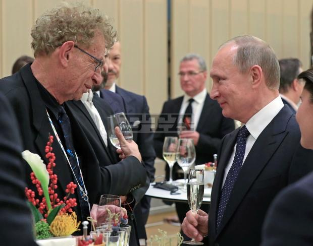 Pianist Daniel Pollack and Russian Federation President Vladimir Putin, toast Pollack's participation in the V. St. Petersburg International Cultural Forum